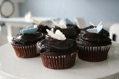 Chocolate Cupcakes. Freshly baked chocolate cupcakes topped with butterfly decorations Royalty Free Stock Photos