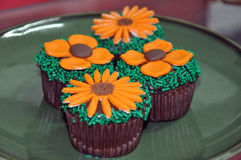Chocolate cupcakes with candy flowers Stock Photos