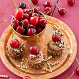 Chocolate cupcakes with cherries Royalty Free Stock Photo