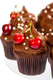 Chocolate cupcakes with cherry Royalty Free Stock Photography