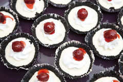 Chocolate cupcakes with cherry jam Stock Photography