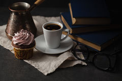 Chocolate cupcakes and coffee on dark background. Photo in a dar Stock Images