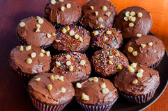 Chocolate cupcakes. With colorful sprinkles Royalty Free Stock Image