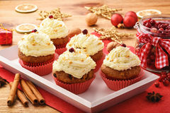 Chocolate cupcakes with cranberries on christmas festive table. Stock Photography