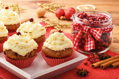 Chocolate cupcakes with cranberries on christmas festive table. Royalty Free Stock Image