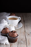 Chocolate cupcakes with a cup of coffee Royalty Free Stock Images