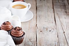 Chocolate cupcakes with a cup of coffee Royalty Free Stock Photo