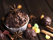 Chocolate cupcakes with filling, sweets on the table stock image