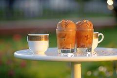Chocolate cupcakes and fresh tea in garden Stock Image