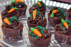 Chocolate cupcakes with frosting carrots Stock Image