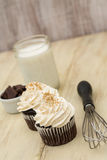 Chocolate Cupcakes with Milk and Wisk Stock Image