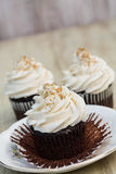Chocolate Cupcakes With One Peeled Open Royalty Free Stock Image