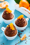 Chocolate cupcakes with orange Royalty Free Stock Image