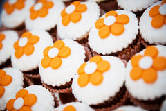 Chocolate cupcakes with orange flowers Royalty Free Stock Photography