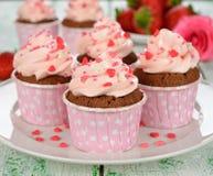 Chocolate cupcakes with pink cream Stock Photos