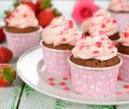 Chocolate cupcakes with pink cream Royalty Free Stock Photos