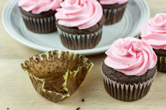 Chocolate Cupcakes with pink icing Stock Image
