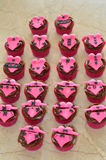 Chocolate Cupcakes with Pink Lingerie Decorations Royalty Free Stock Images