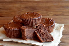 Chocolate cupcakes recipe. Sweet delicious cupcakes made from butter, cocoa, chocolate, sugar, flour, eggs. Oven baked muffins. A lot of chocolate cupcakes on Royalty Free Stock Photography