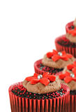 Chocolate cupcakes in red cups Stock Photos