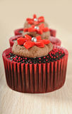 Chocolate cupcakes in red cups Royalty Free Stock Photography