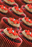 Chocolate cupcakes in red cups Royalty Free Stock Images