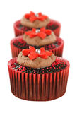Chocolate cupcakes in red cups Stock Photography