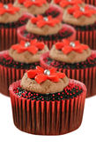 Chocolate cupcakes in red cups Stock Image