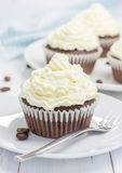 Chocolate cupcakes with ricotta cheese frosting. On the white plate Royalty Free Stock Photography