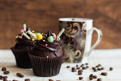 Chocolate cupcakes on rustic wooden background Royalty Free Stock Image