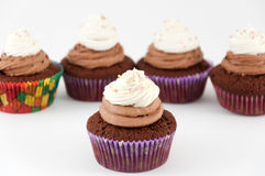 Chocolate cupcakes with sprinkles Stock Photo