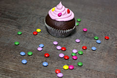 Chocolate cupcakes with strawberries cream. On wooden table Stock Photo