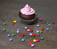 Chocolate cupcakes with strawberries cream. On wooden table Stock Photography