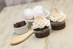 Chocolate Cupcakes With Vanilla Icing and Eggs Royalty Free Stock Photography