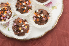 Chocolate cupcakes vintage plate Royalty Free Stock Photography