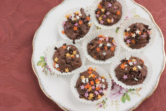 Chocolate cupcakes vintage plate Royalty Free Stock Images