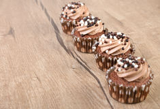 Chocolate cupcakes on wood Royalty Free Stock Image