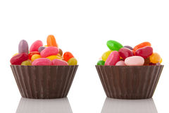 Chocolate cups jelly beans Stock Photos