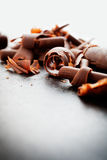 Chocolate curls. Close up of chocolate curls, used for cade decoration royalty free stock photography
