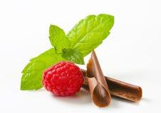Chocolate curls and fresh raspberry Stock Photo