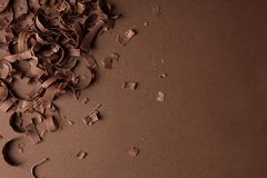 Chocolate curls and space for text on color background, top view stock photos