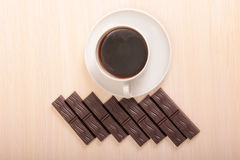 Chocolate cut and coffee mag. Coffee cup and chocolate on a wood background Stock Photo