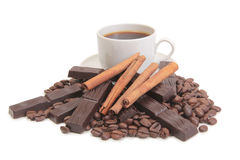 Chocolate cut and mag. Coffee cup and chocolate on a wood background Royalty Free Stock Images