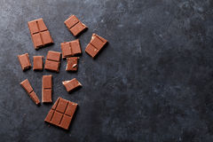 Chocolate. On dark stone background. Top view with copy space Stock Photo