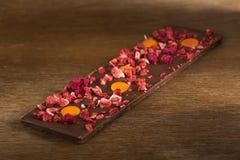 Chocolate de leite da laranja, da morango e da framboesa Imagens de Stock Royalty Free
