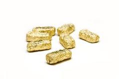 Chocolate de oro de empaquetado del huevo de oro de pascua Foto de archivo