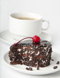 Chocolate dessert. Cup of coffee and chocolate dessert with a cherry Stock Photos
