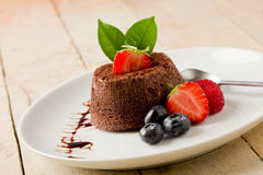 Chocolate dessert with berries royalty free stock photos