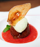 Chocolate dessert with berry sauce and ice-cream Stock Photography