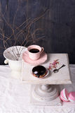 Chocolate dessert and coffee in pink cup on vintage table. Stock Images